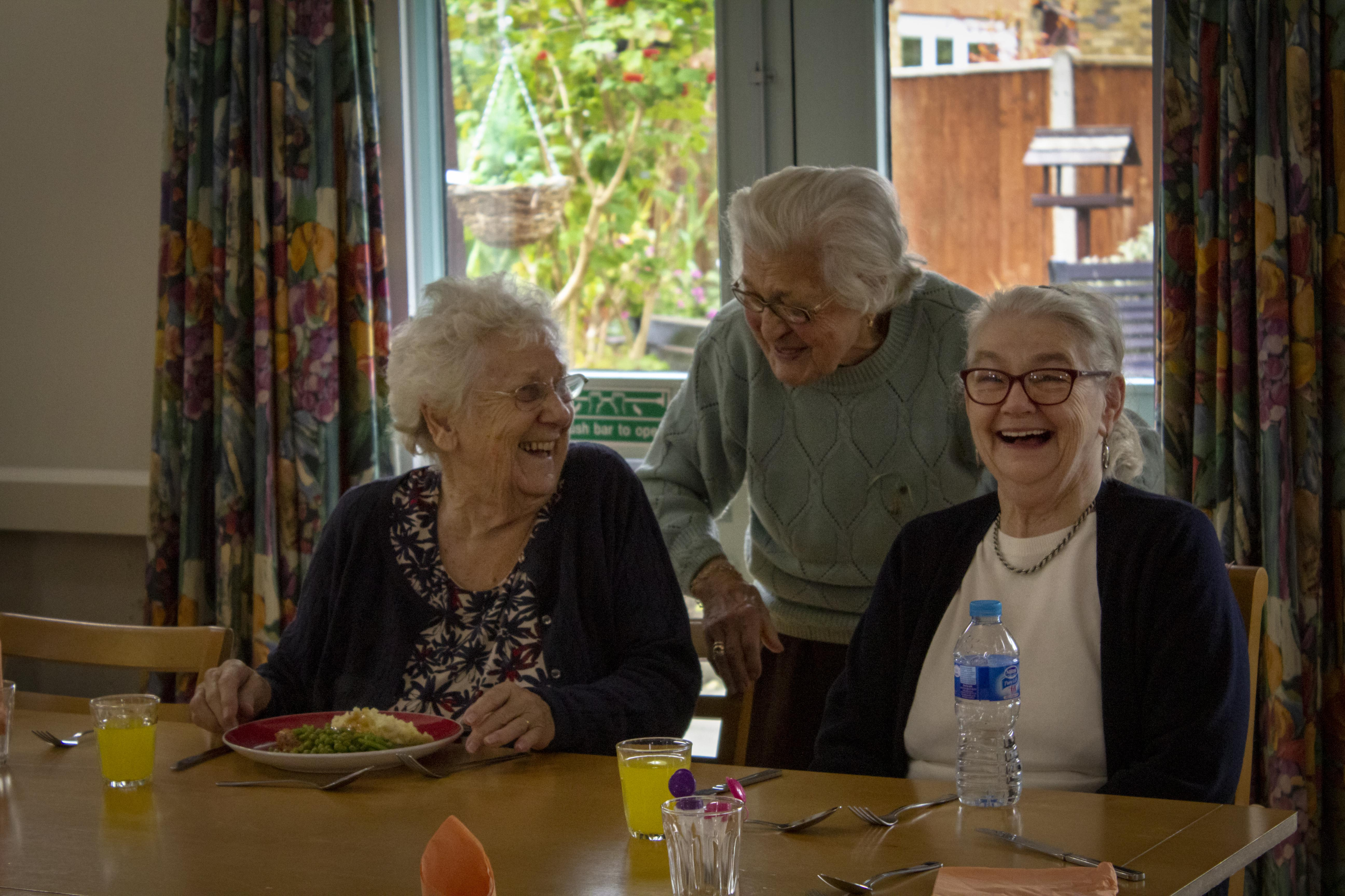 Daybreak Oxford club members enjoy lunchtime together